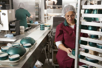A Saint Luke's nutrition worker, putting together nutritious meals for the patients