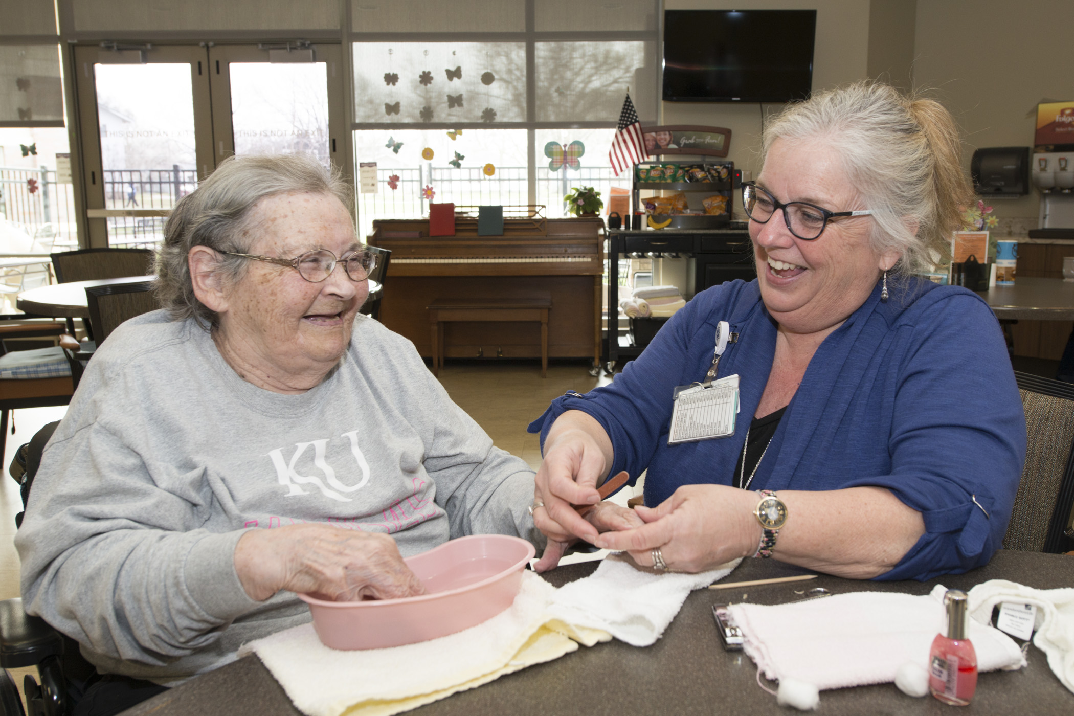 A provider laughs with a patient at the Residential Living Center, named one of the best nursing homes in Kansas by U.S. News & World Report
