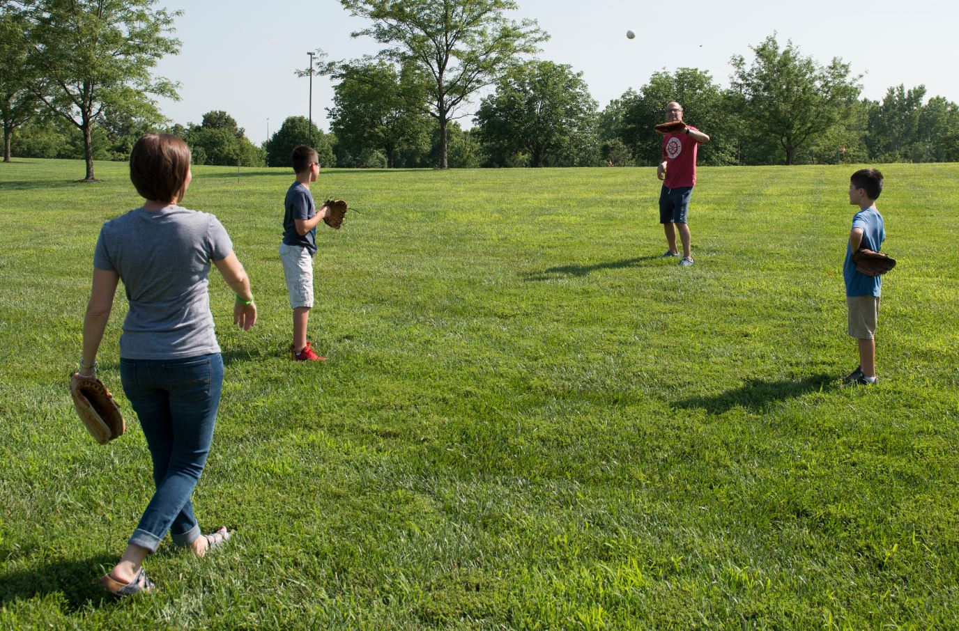 Andrew Widman, heart transplant recipient, playing catch with family