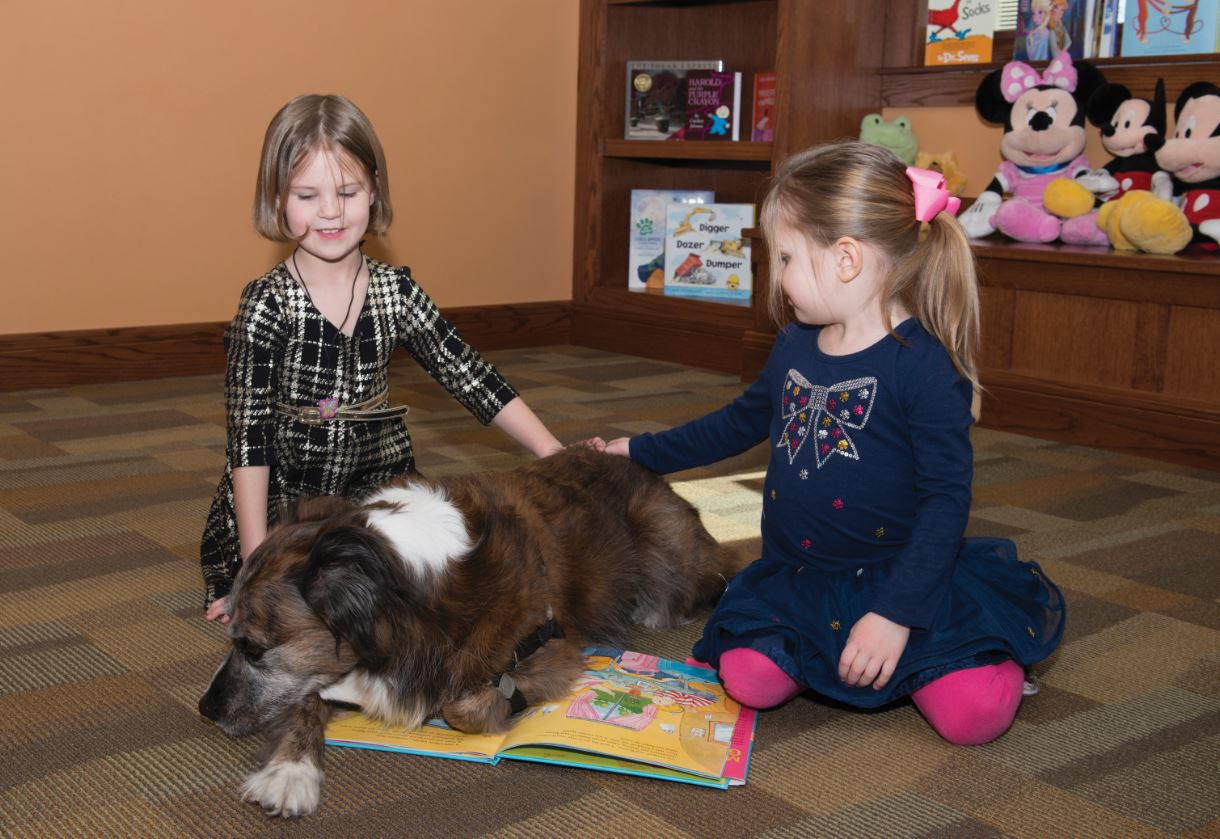 Molly - DOC - comforting patients at Saint Luke's Hospice House
