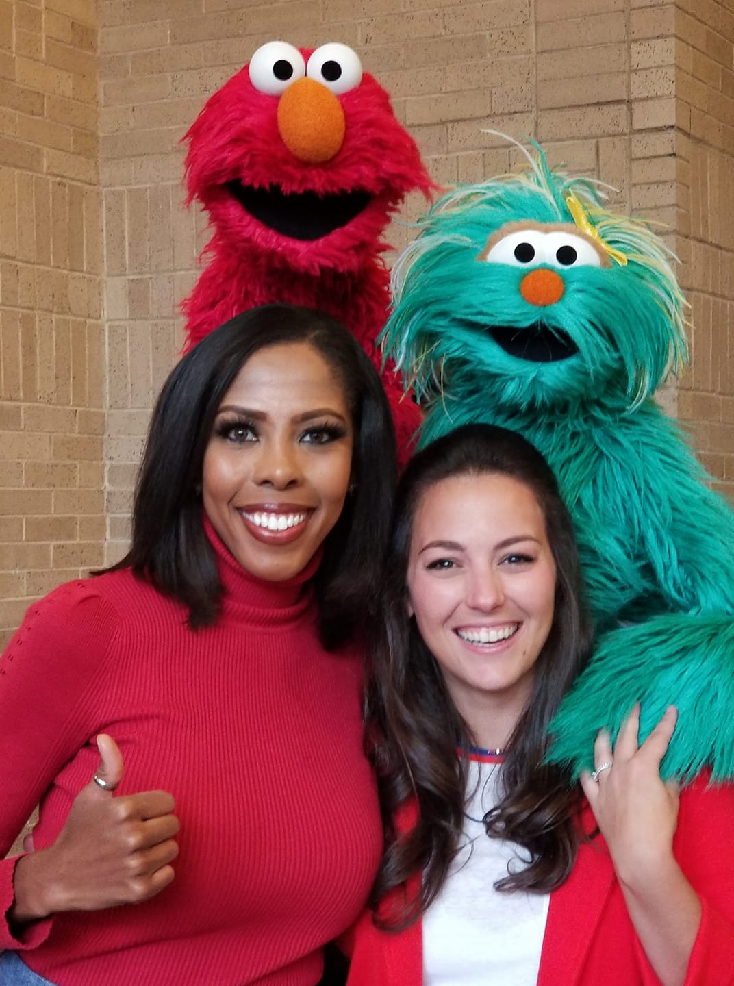 FOX4's Dhominique Ricks and Sesame Street's Elmo, Rosita and Nina pose together at Rock It!
