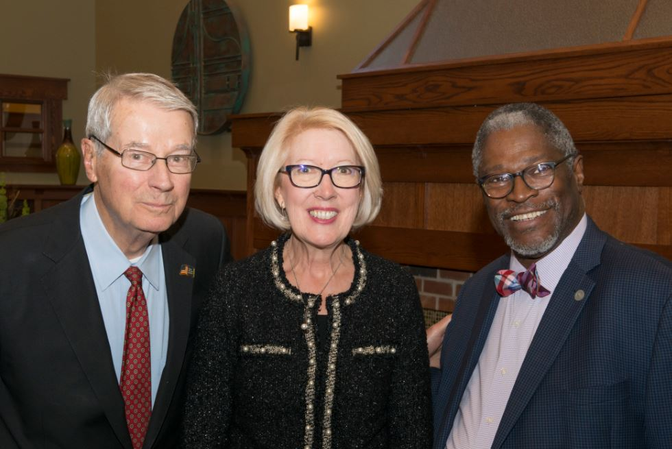 Larry McMullen, Carol Quiring and Mayor Sly James come together for a photo at the five year anniversary celebration of Saint Luke's Hospice House