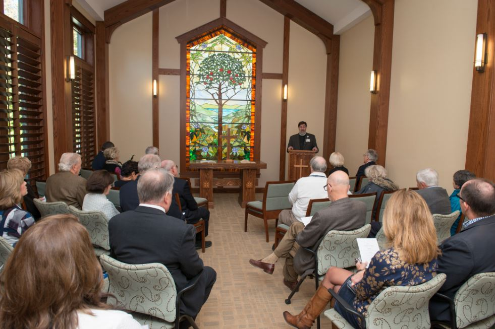 Rev. Marshall Scott opening the anniversary celebration of Saint Luke's Hospice House with a prayer in the chapel