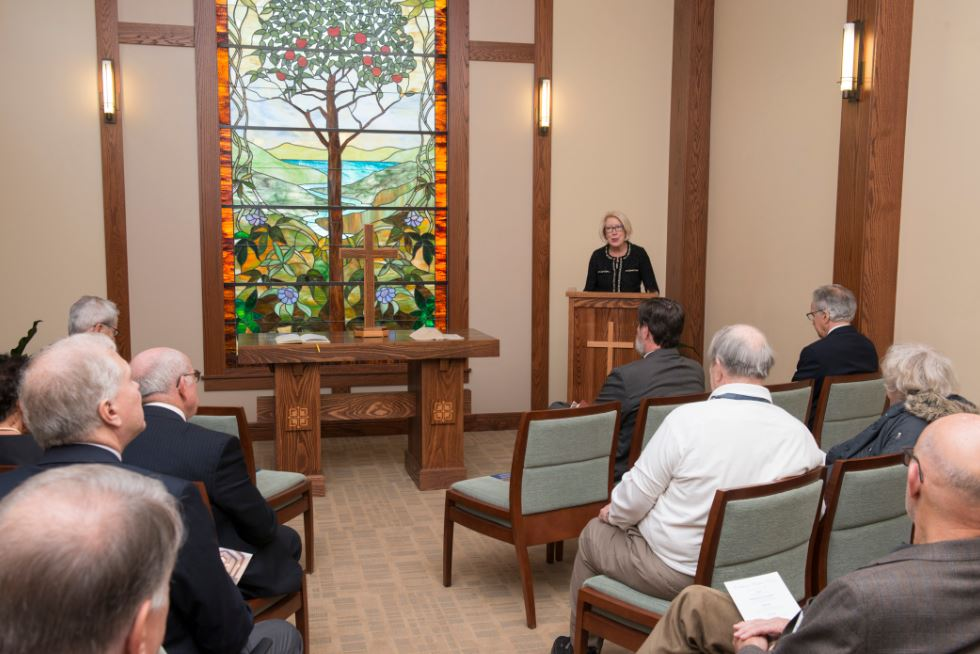 Saint Luke's Hospice House CEO, Carol Quiring, speaks at the five year anniversary celebration in the Hospice House chapel