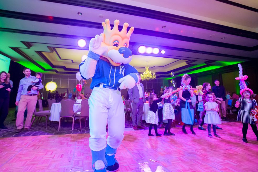 Slugger dancing with kids on the dance floor at Once Upon a Time