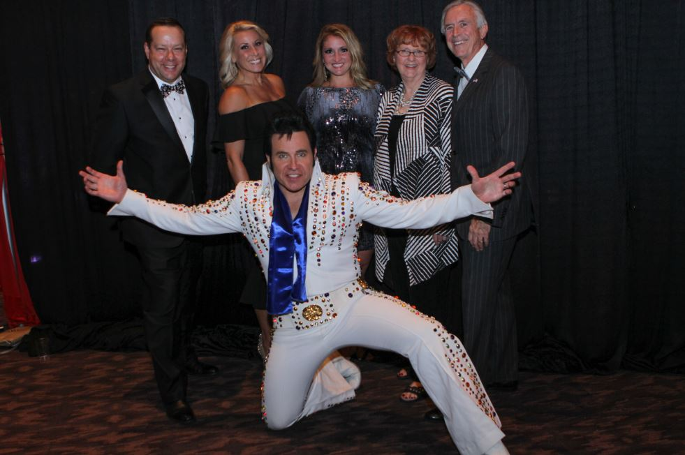 Saint Luke's East, CEO Ron Baker with guests, and Elvis, at annual Boo Ball event