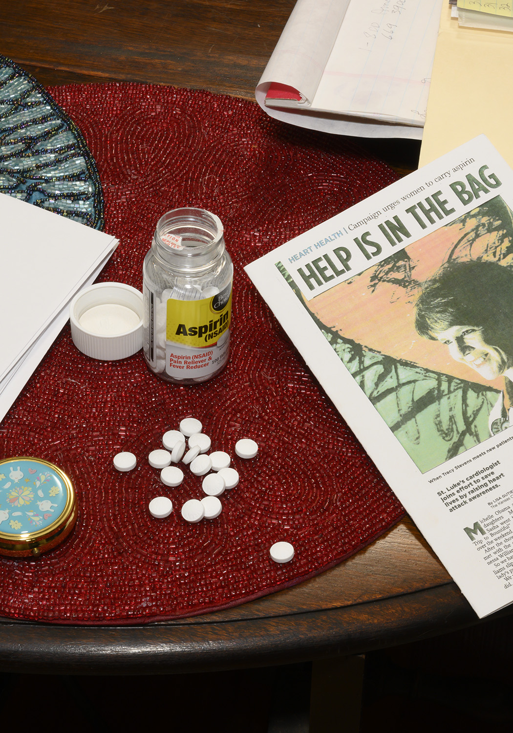 Aspirin and Dr. Stevens article that Dixie made into a card that reads, 'Help is in the Bag.'