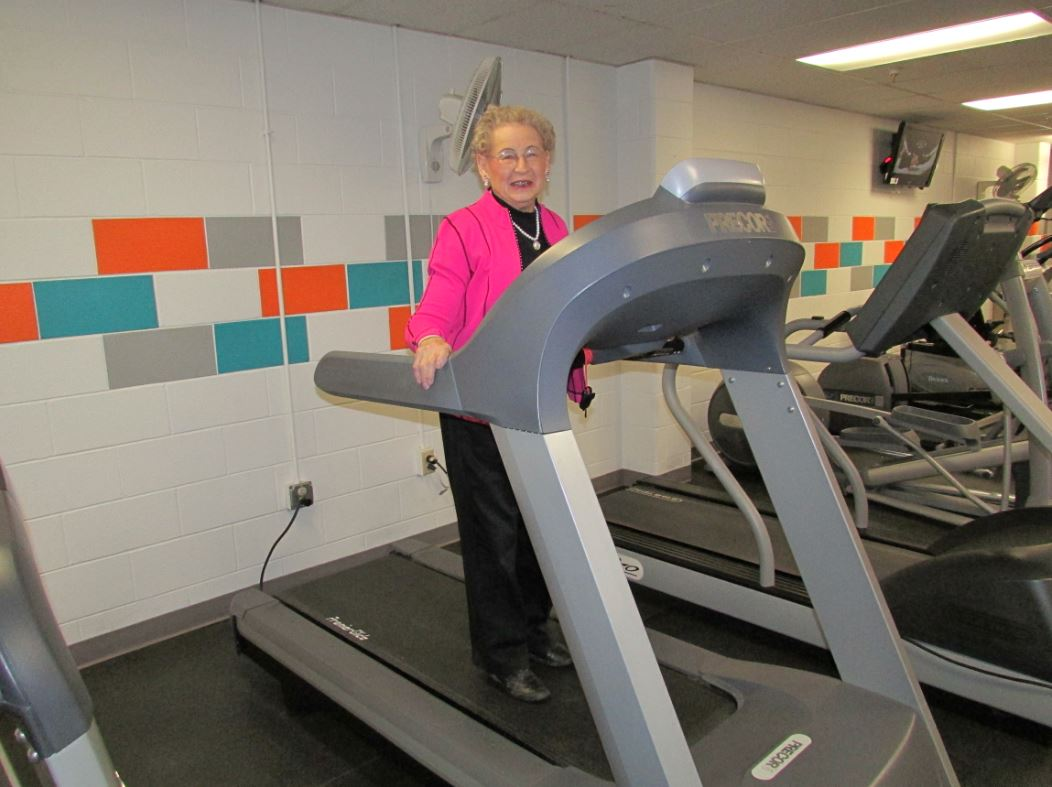 Bettie B. on the treadmill in the SHAPE Fitness Center
