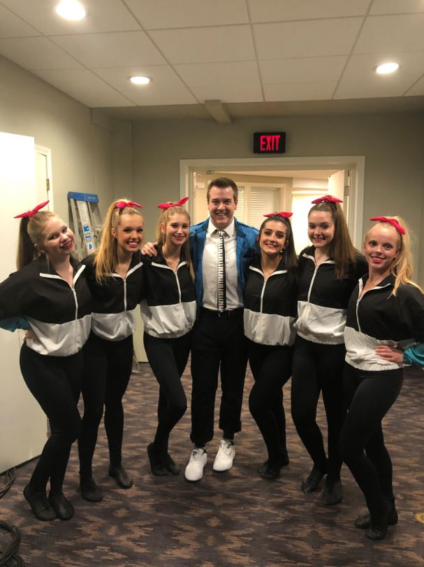 KMBC's Cody Holyoke with volunteers at Boo Ball