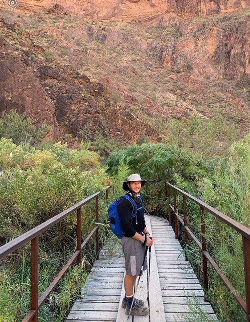 Nate Miller crossing a bridge during the Grand Canyon Hunger Walk