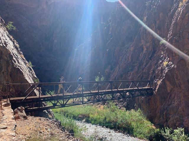 Grand Canyon hunger walk hikers crossing a bridge