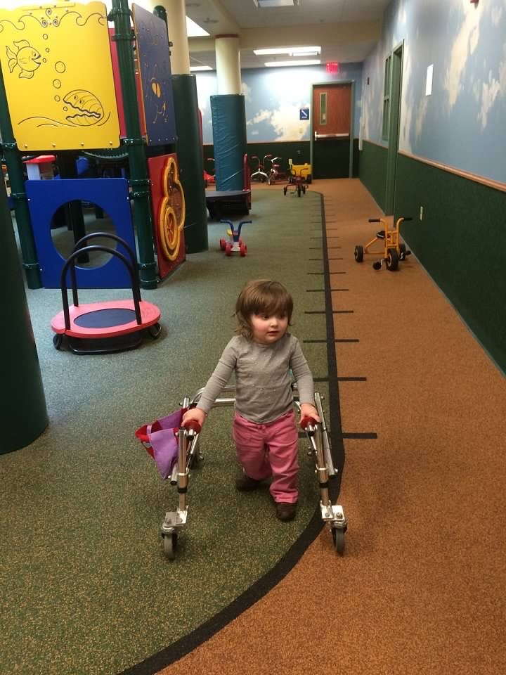 In March 2015, Amelia got her reverse walker. She loved using it at the SPOT (pictured here) or anywhere with wide open spaces. She would zoom through Target and her mom, Jennifer, prayed she wouldn't knock anyone down!
