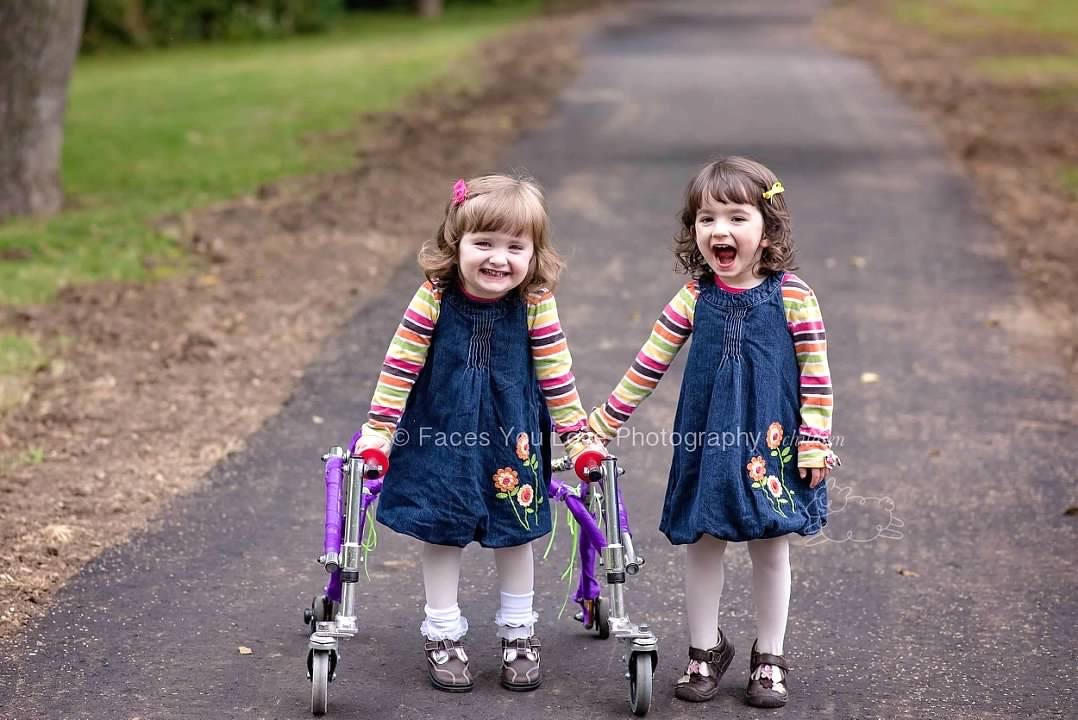In October 2015, Amelia and her twin sister, Sarah, explored the walking trail in their neighborhood park.  (Photo credit Faces You Love Photography/Helen Ransom)