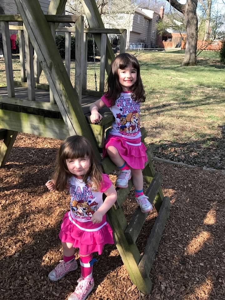 Amelia, pictured with her twin sister, Sarah, practiced walking on uneven surfaces (like grass or wood chips) and climbing play equipment in their backyard in the spring 2017.