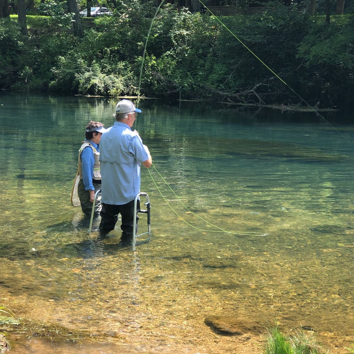 Pat and Janelle Carey fly fishing in the river