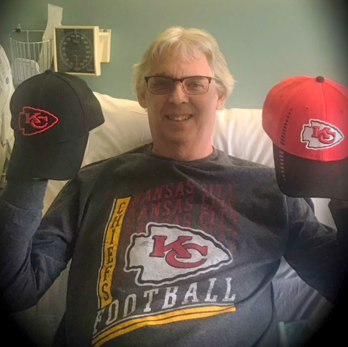 Pat Carey with his Chiefs hats for offense and defense