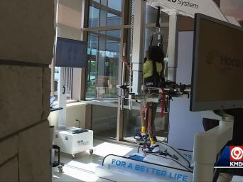 KMBC 9 abc. 91 degrees. 6:15. Woman utilizing robotic equipment as part of her rehabilitation.