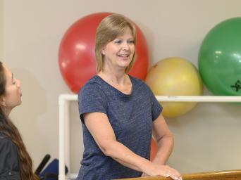 Susan Rushing working with her physical therapist