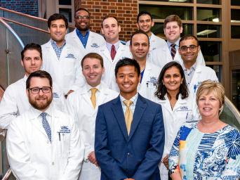 Cardiovascular Fellows, 2019, gathered together for a group photo on the staircase at Saint Luke's Hospital of Kansas City.