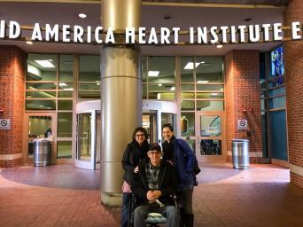 Pat Carey with his wife and daughter in front of Saint Luke's Mid America Heart Institute entrance