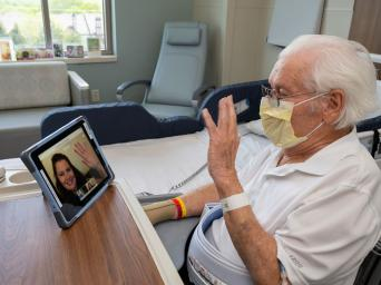 Don, a patient at Saint Luke's, connects with his daughter, Deb, on an iPad since she can't visit him in the hospital due to COVID-19.