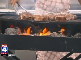 FOX 4 News. Man cooking steaks over a grill.